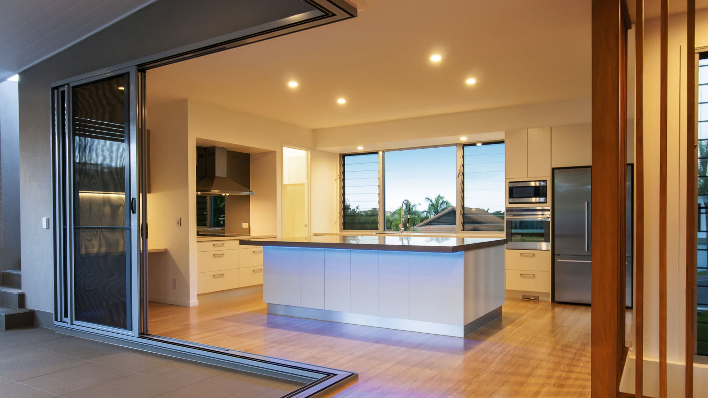 Aluminium Corner Sliding Doors in a kitchen