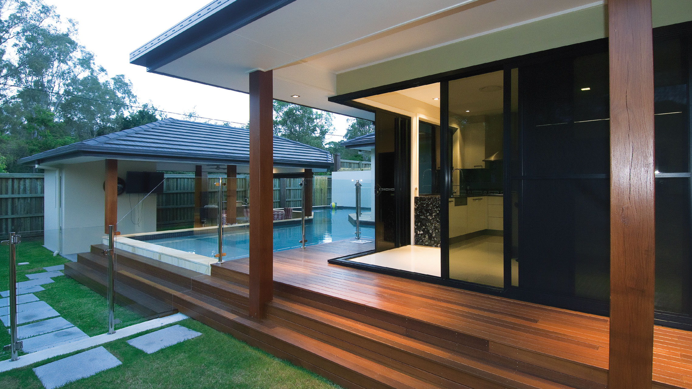 Black Aluminium Corner Sliding Doors with grey glass