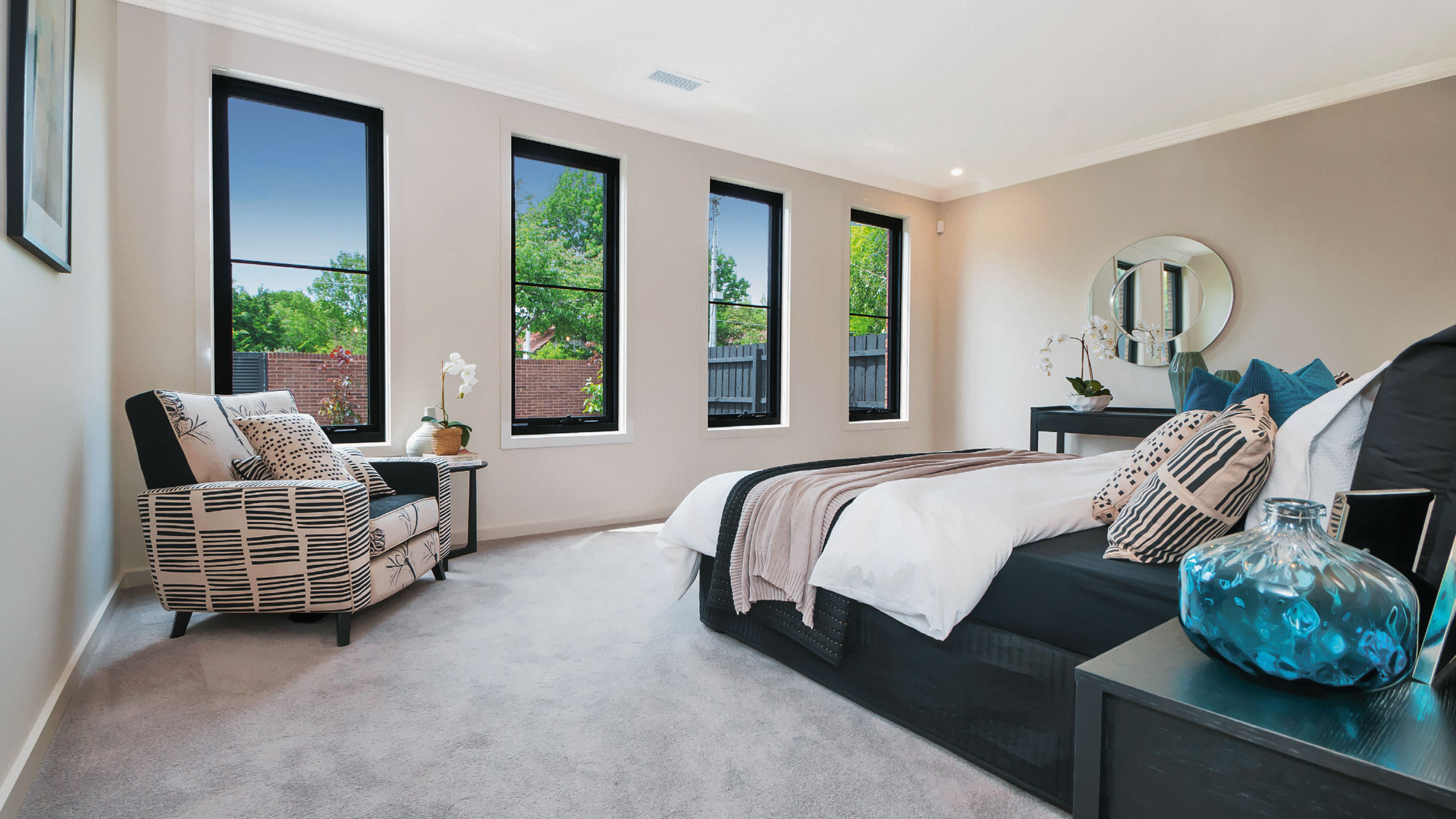 Four Black Aluminium Awning Windows in a bedroom