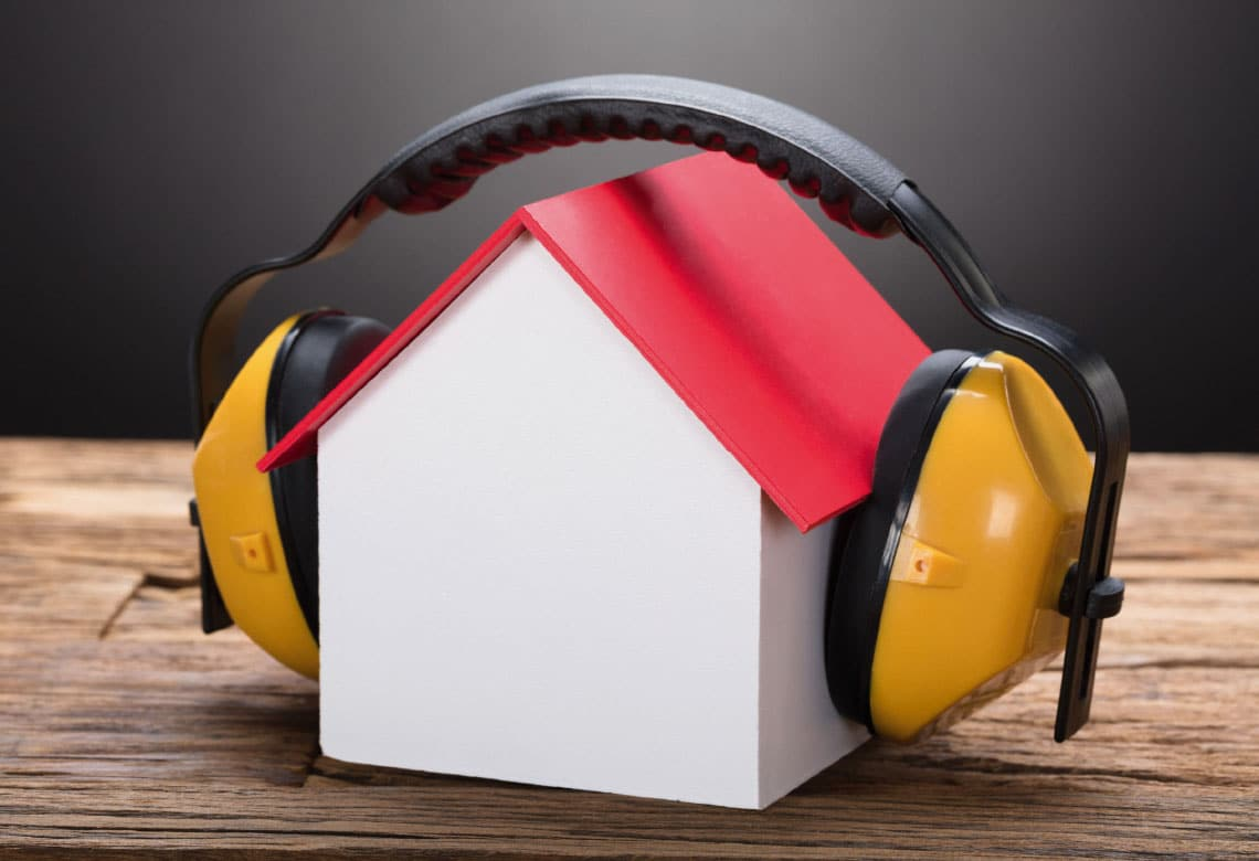 Headphones covering a miniature house