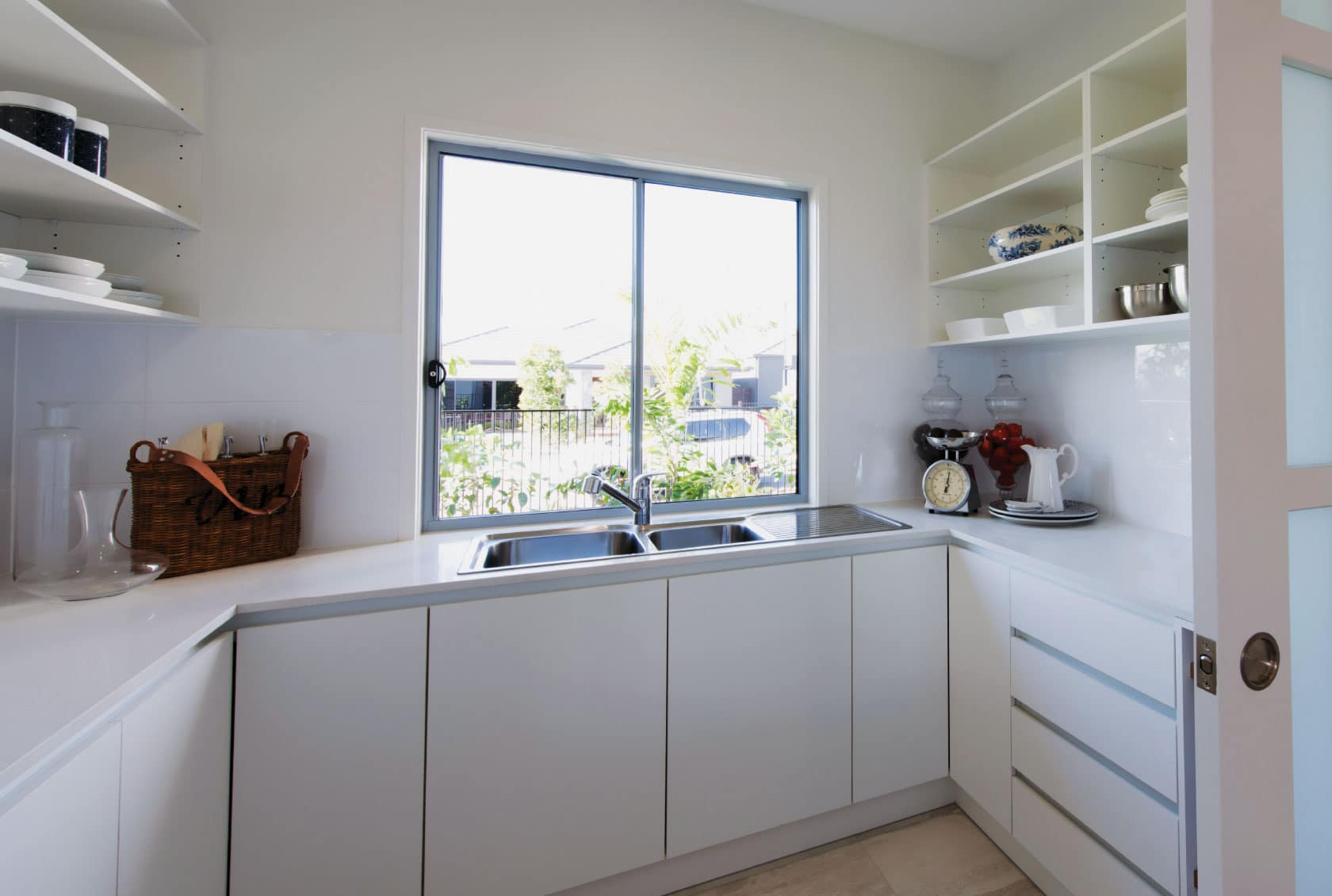 Ultra Silver Aluminium Sliding Windows on a kitchen bench