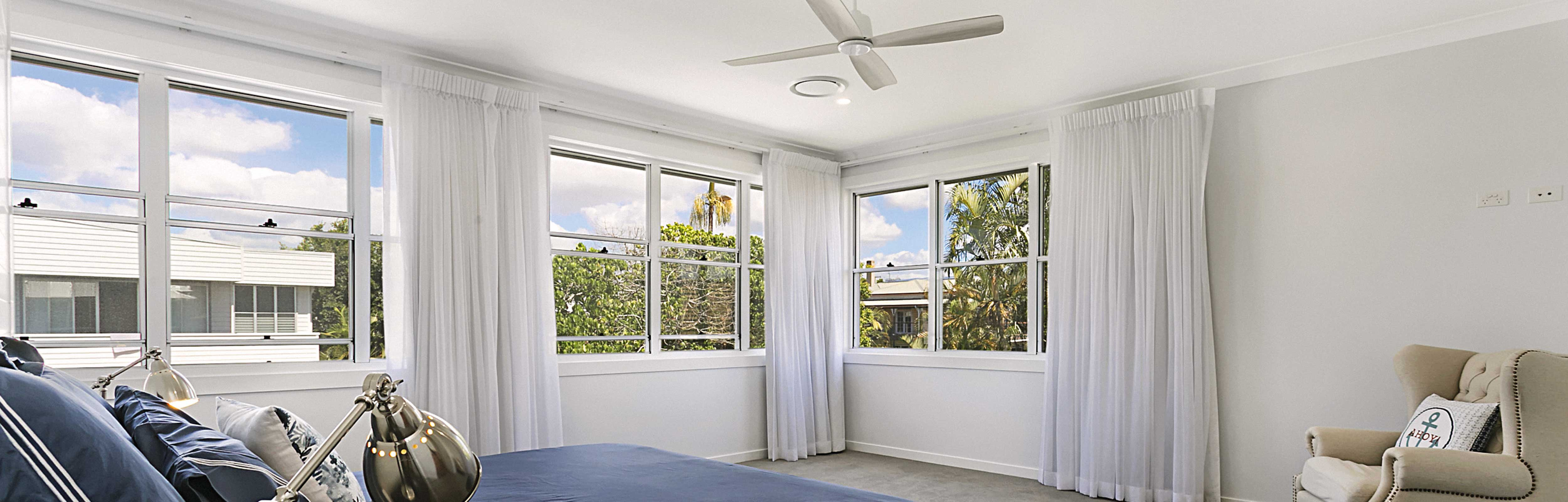 White Aluminium Double Hung Windows in a bedroom