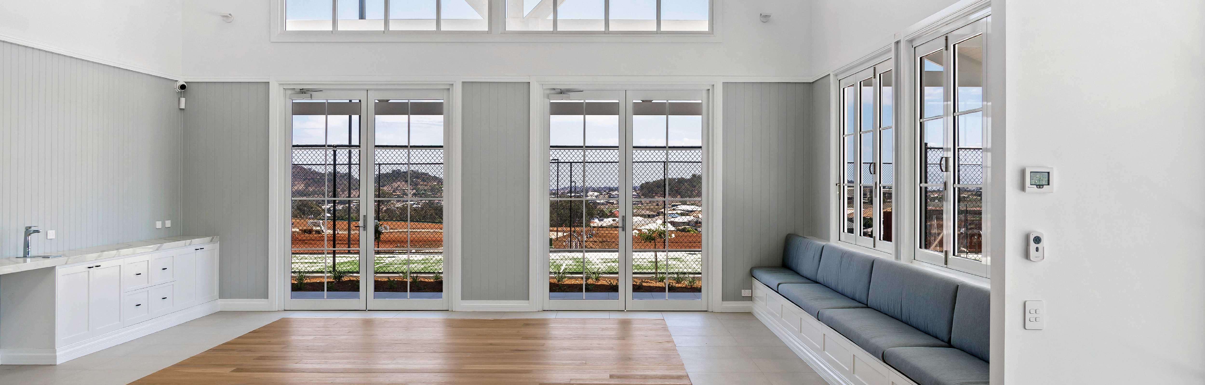 White Aluminium Hinged Doors with designer bars