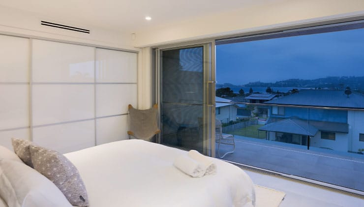 Aluminium Sliding Door with Ultra Silver frame and architectural handle