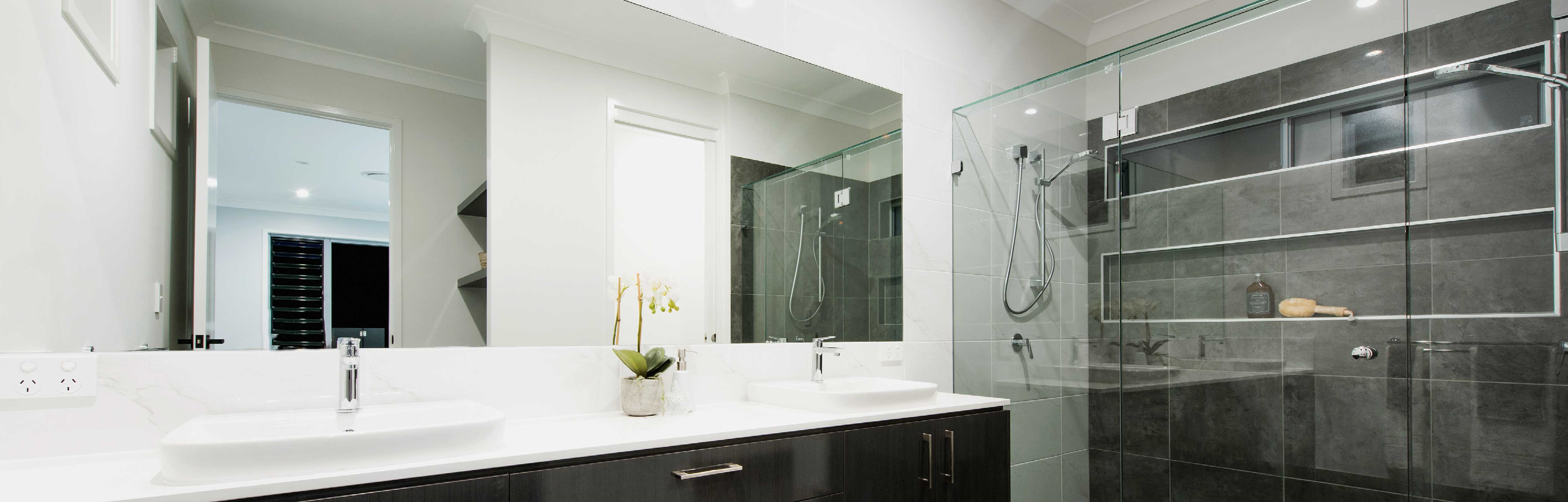 Large Frameless Mirror in a bathroom