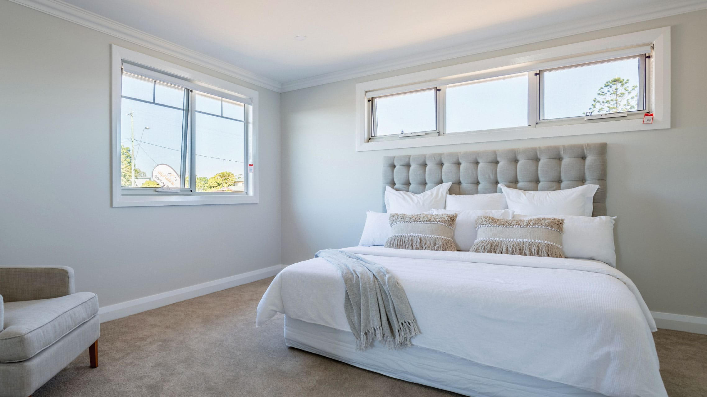 Two White Aluminium Awning Windows in a bedroom