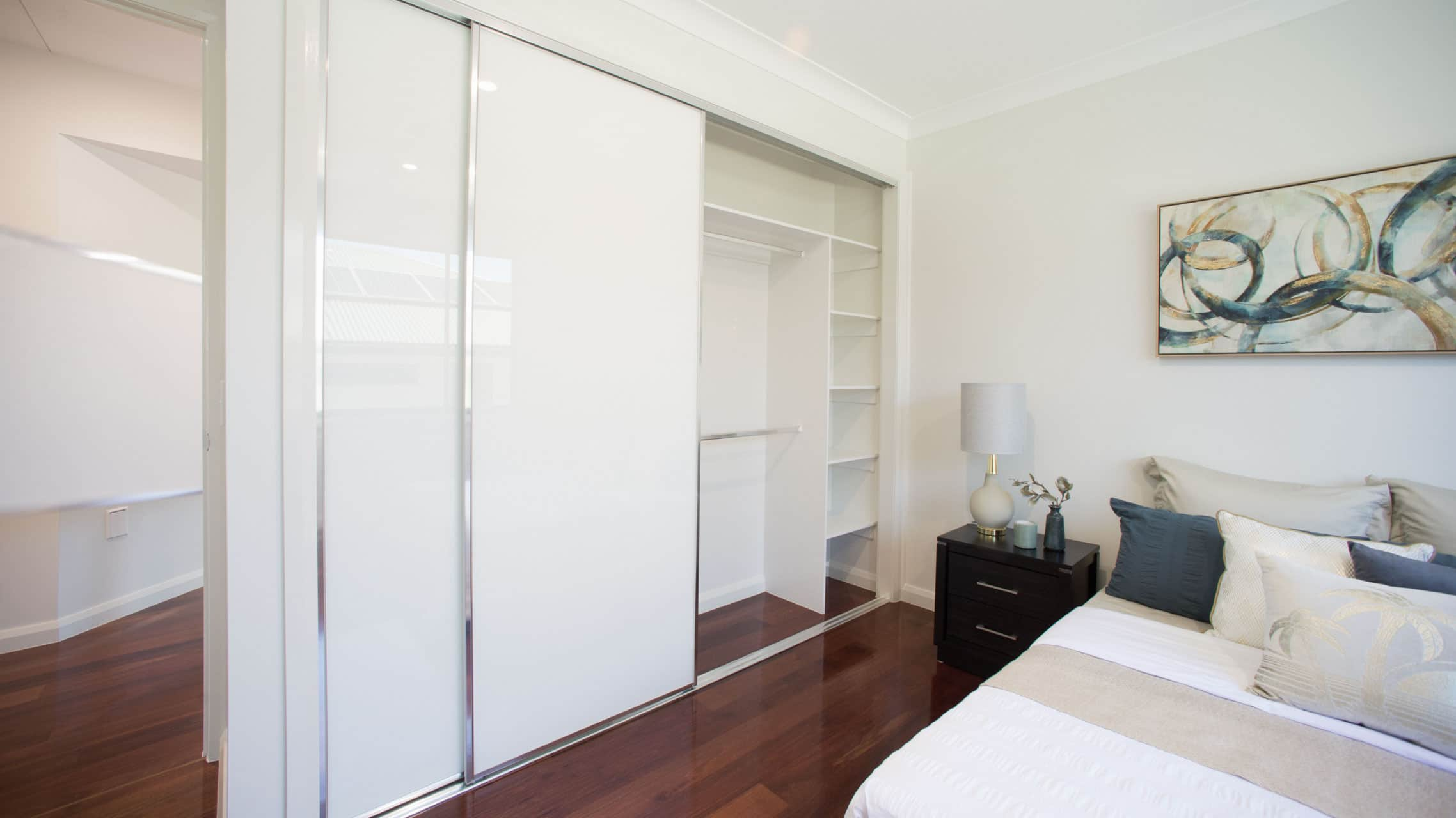 Coloured Glass Sliding Wardrobe Doors in a bedroom