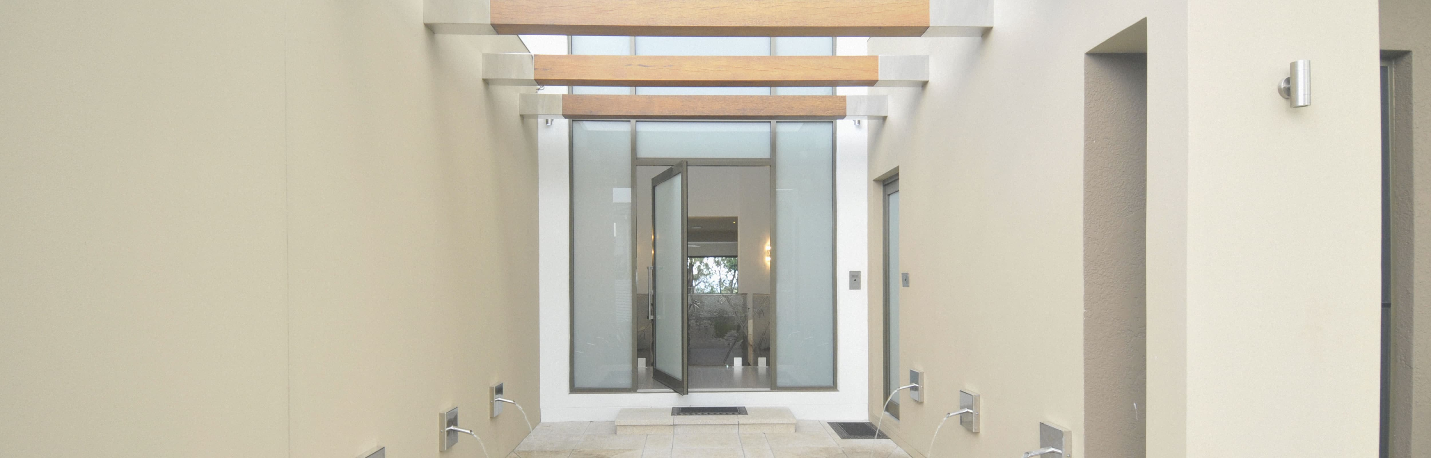 Black Aluminium Pivot Door with obscure glass