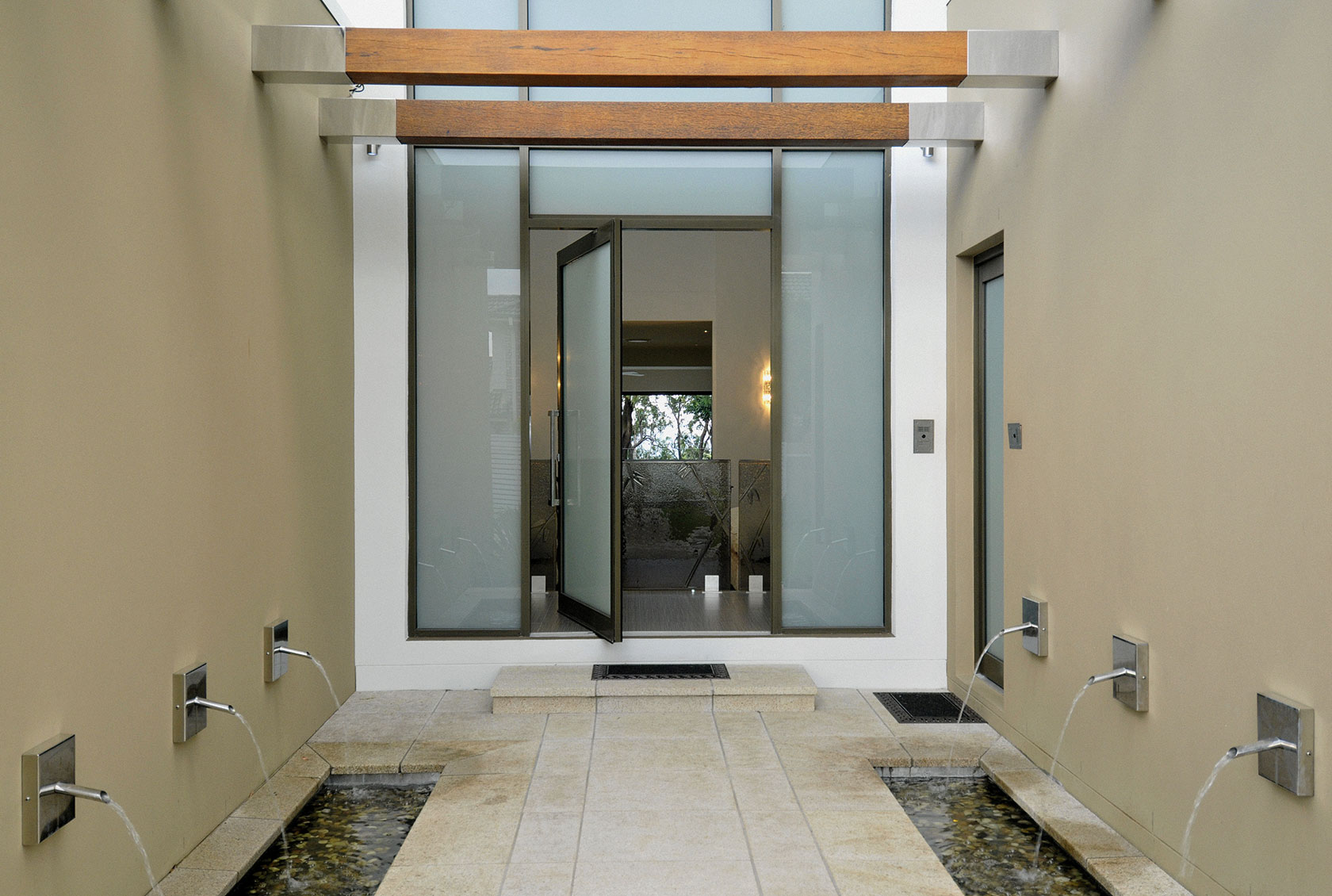 Aluminium Pivot Door with obscure glass