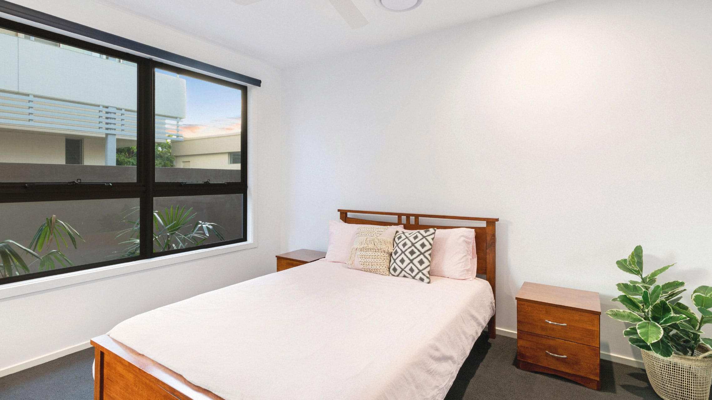 Aluminium awning windows with low lites in a bedroom