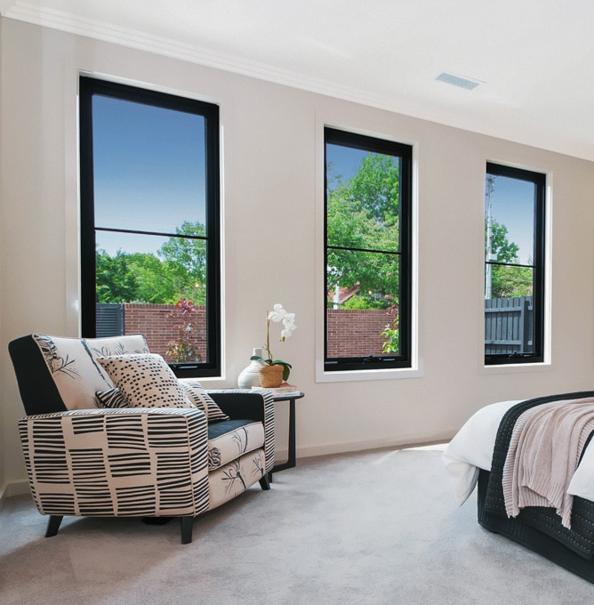 Four Black Awning Windows in a bedroom