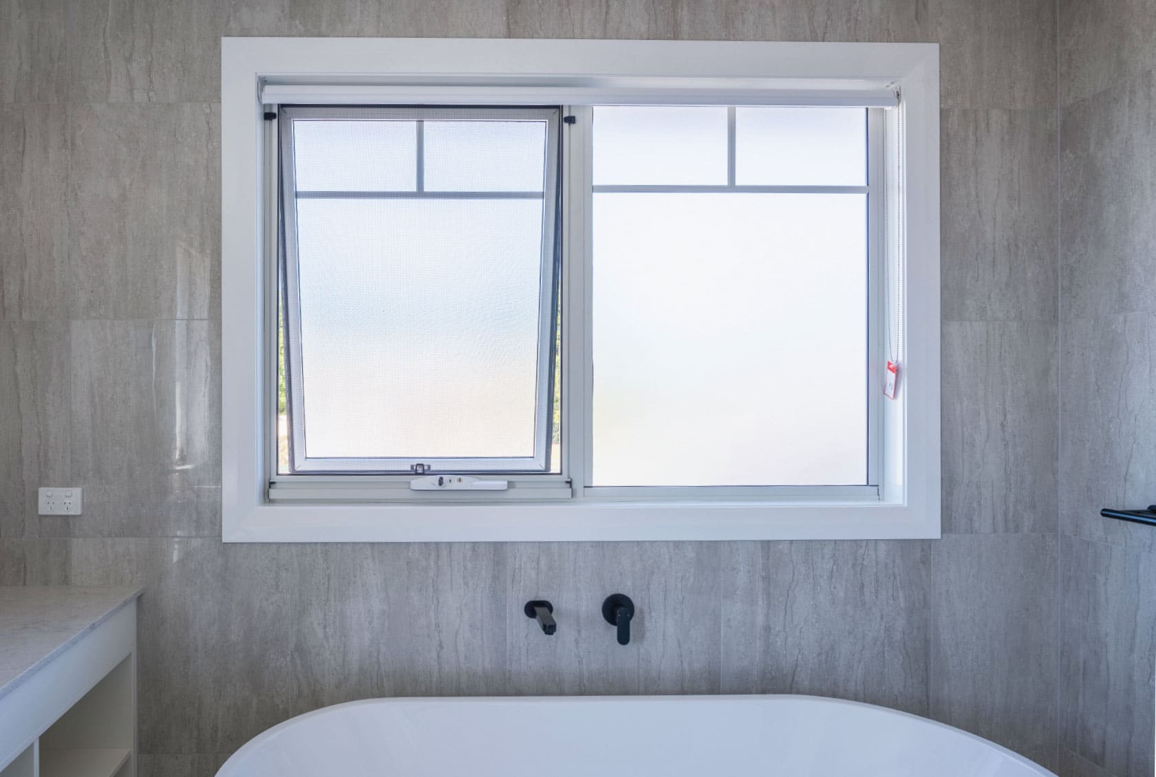 White Awning Window in a bathroom