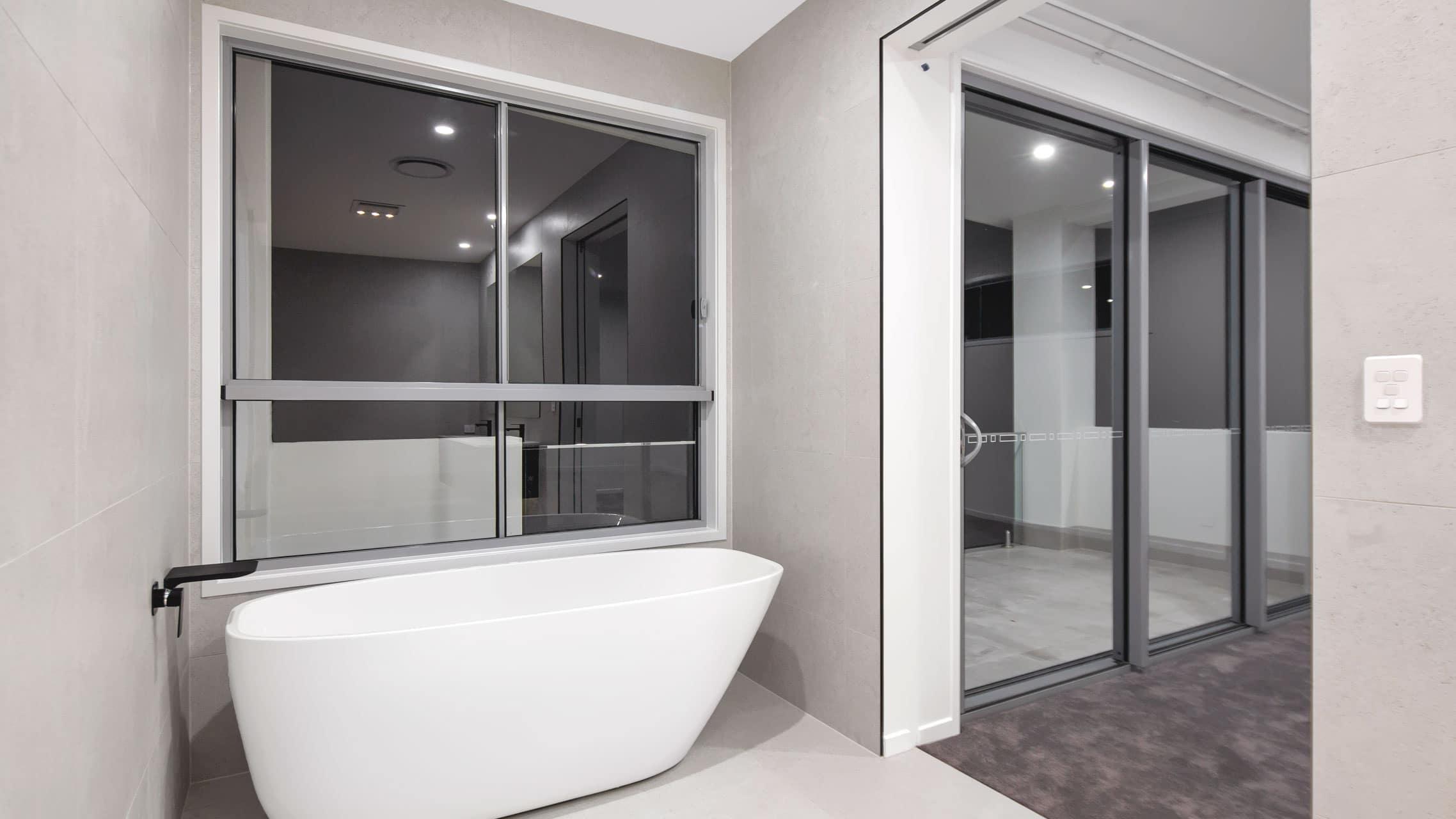 Large Sliding Window next to a bathtub