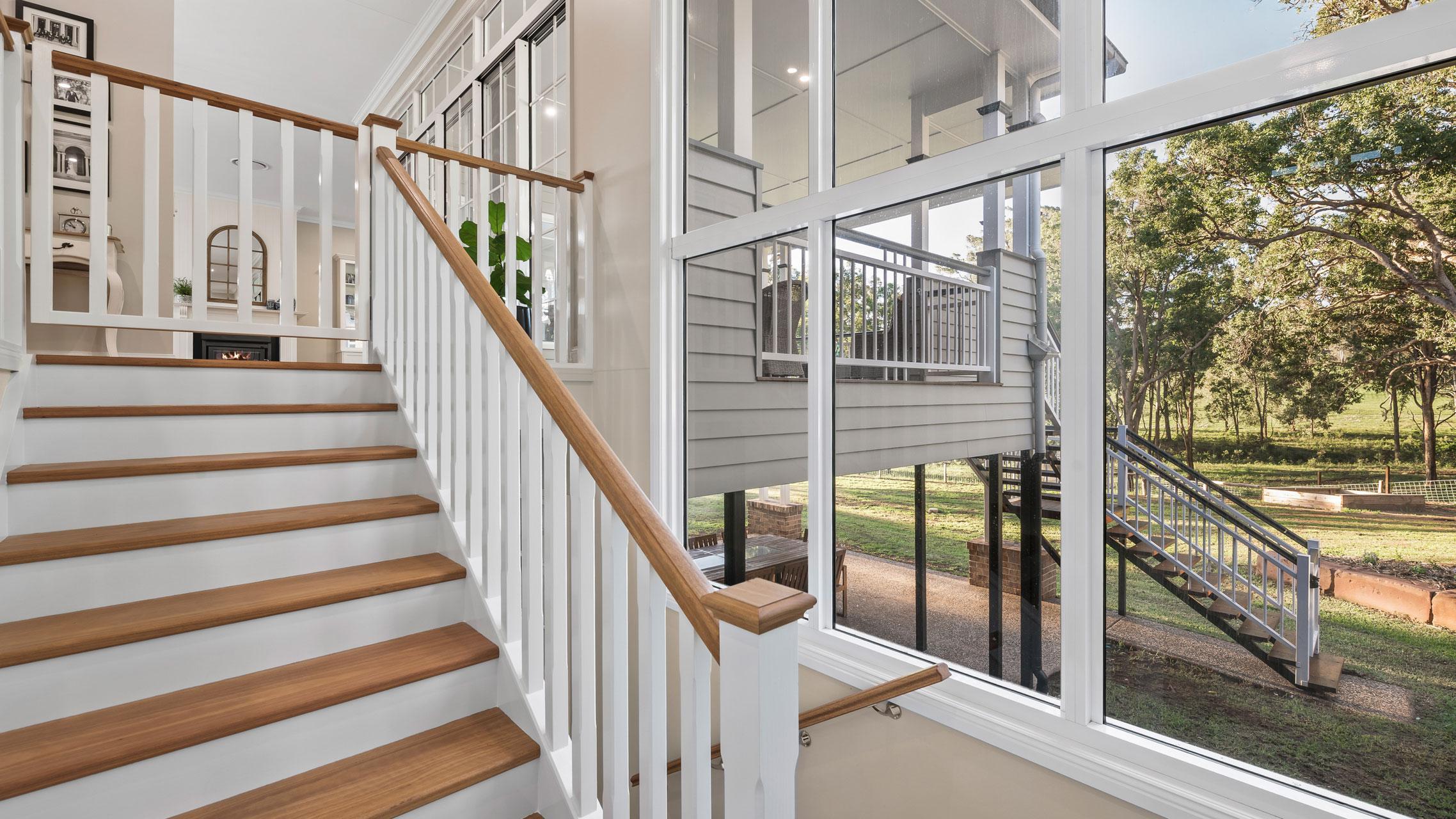 Large Aluminium Windows next to a staircase