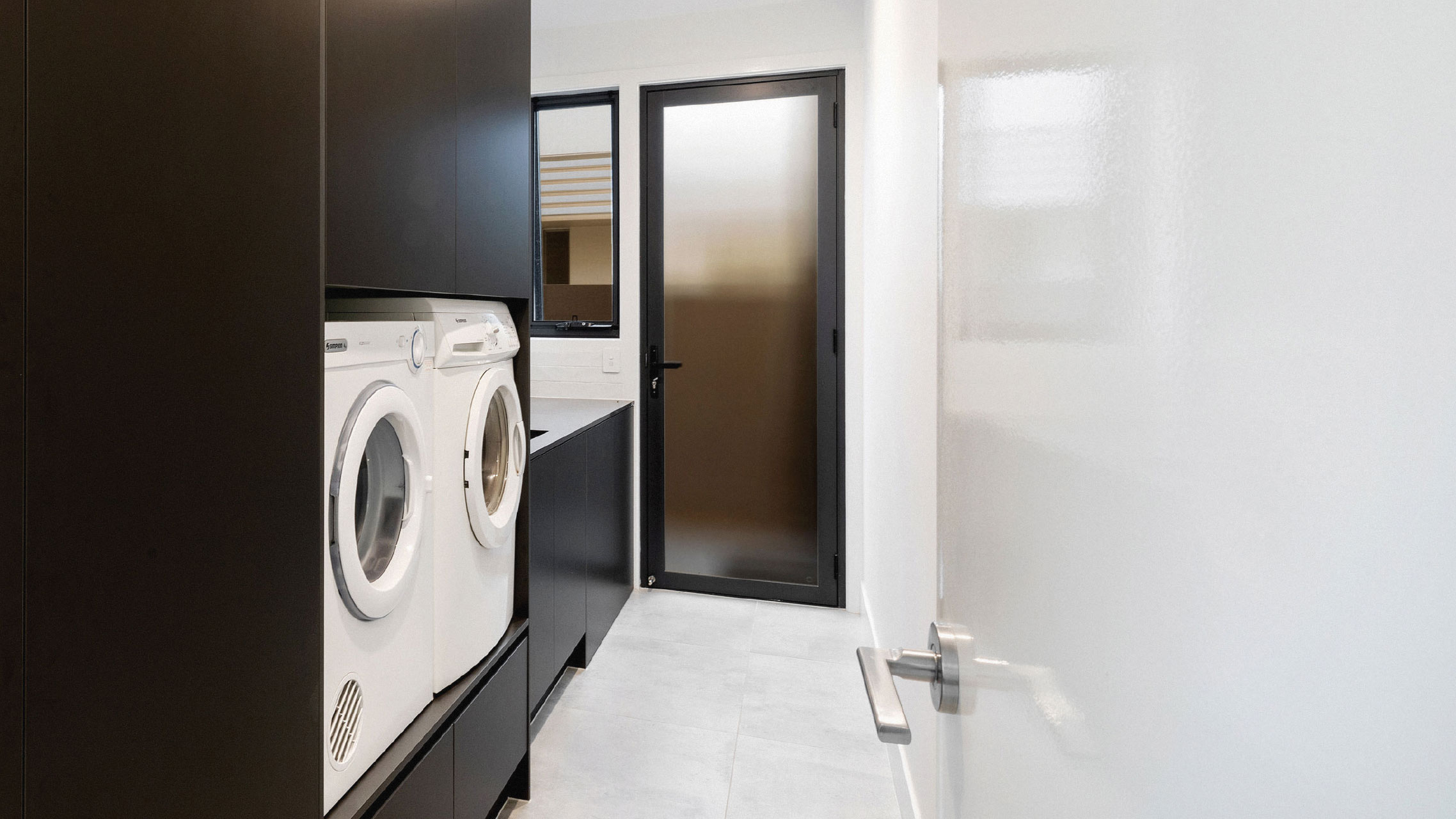 Black French Door with obscure glass in a laundry