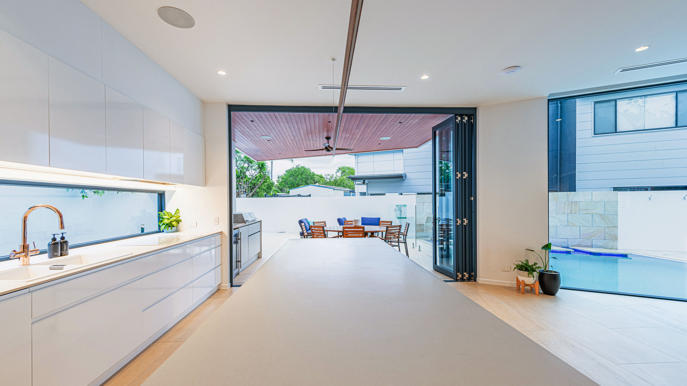Blue Folding Door connecting inside and outside