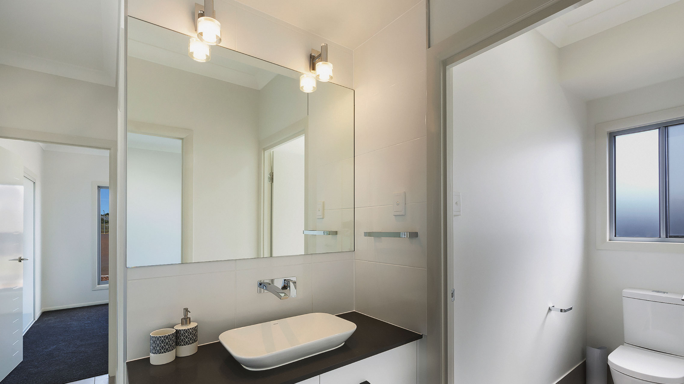 Frameless Bathroom Mirror with two light fittings above it