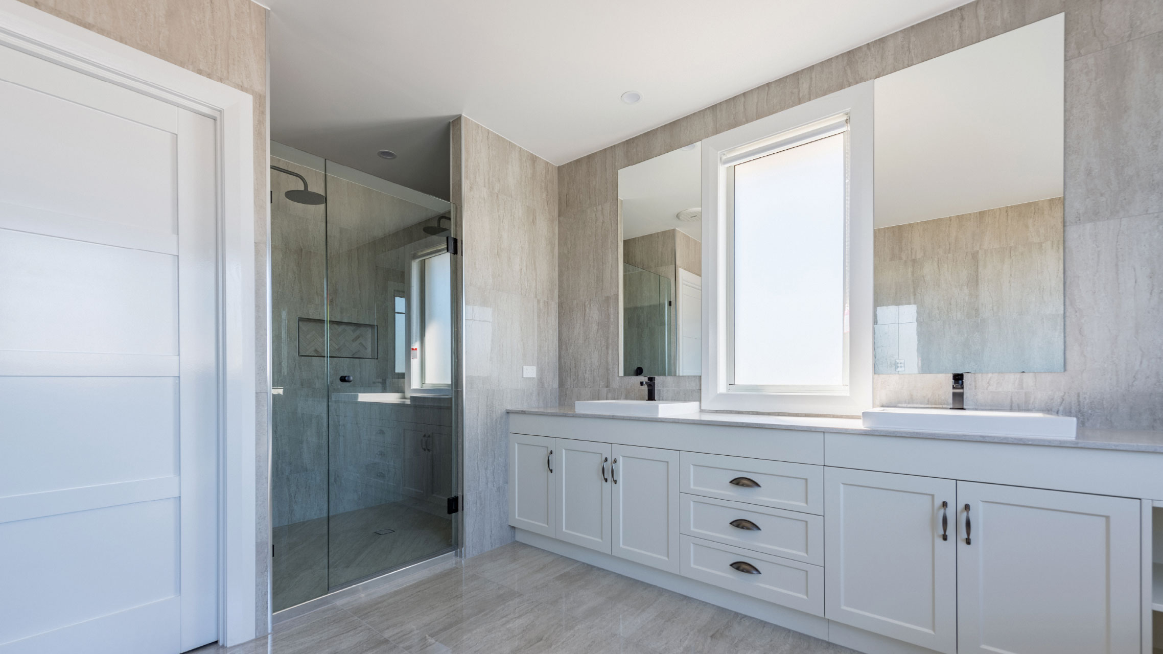Two Bathroom Mirrors next to a fixed window