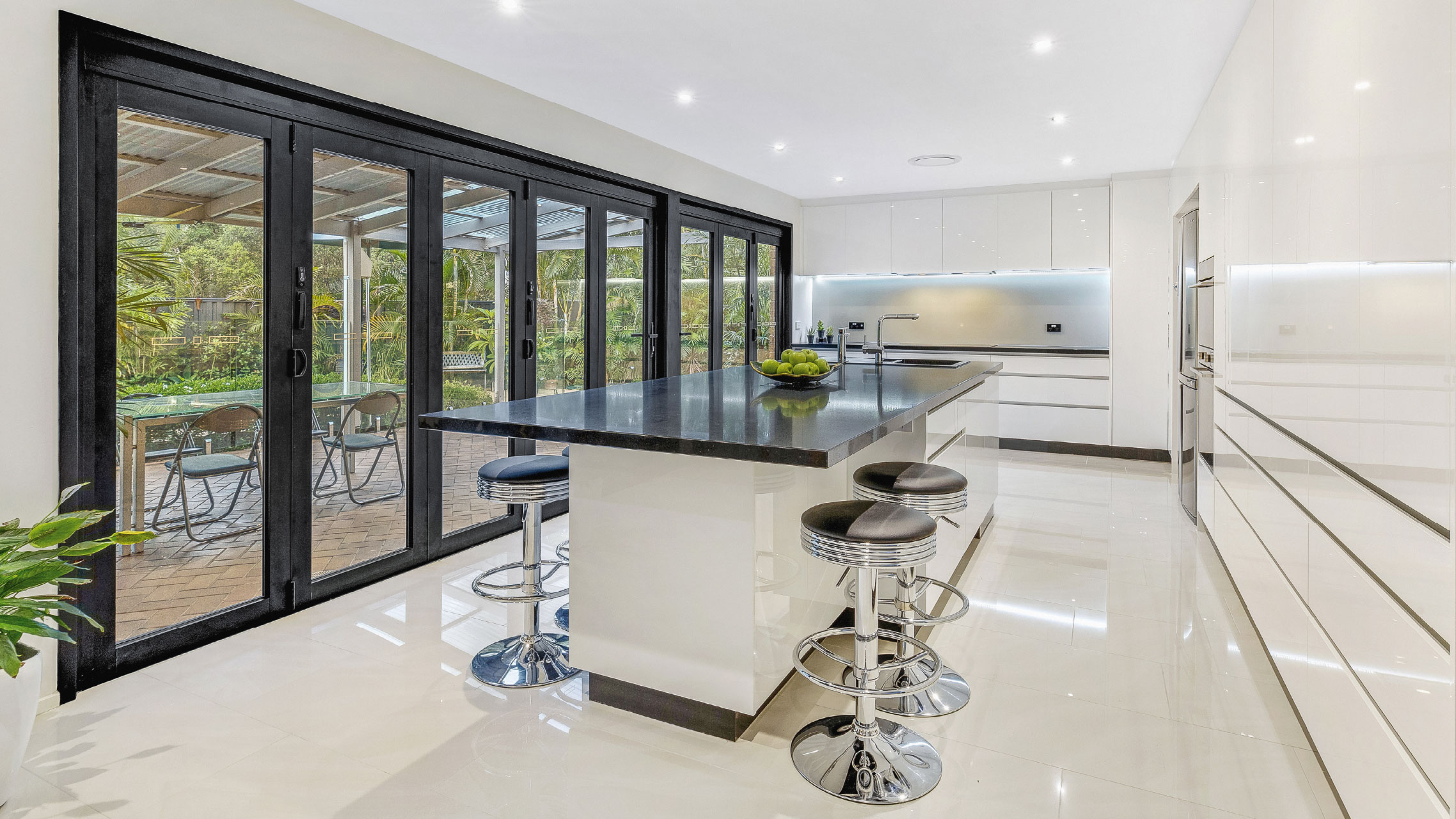 wo Black Bifold Doors separated by a post