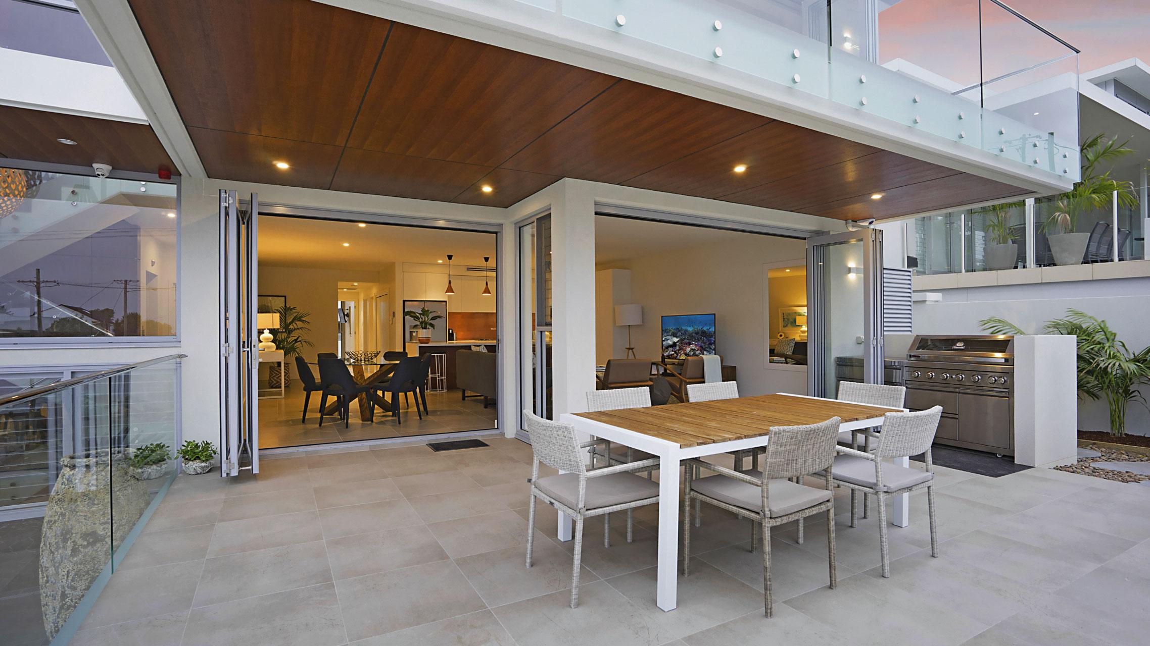 Ultra Silver Bifold Doors opening to a courtyard